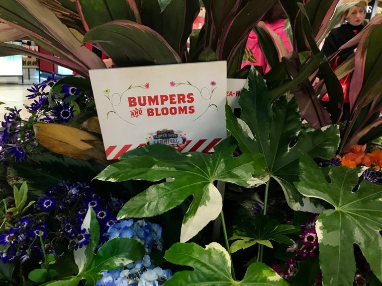 Bumpers and Blooms sign at the Macy's Flower Show