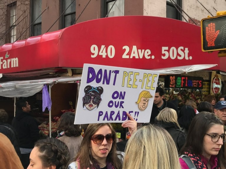 Pee tape protest sign