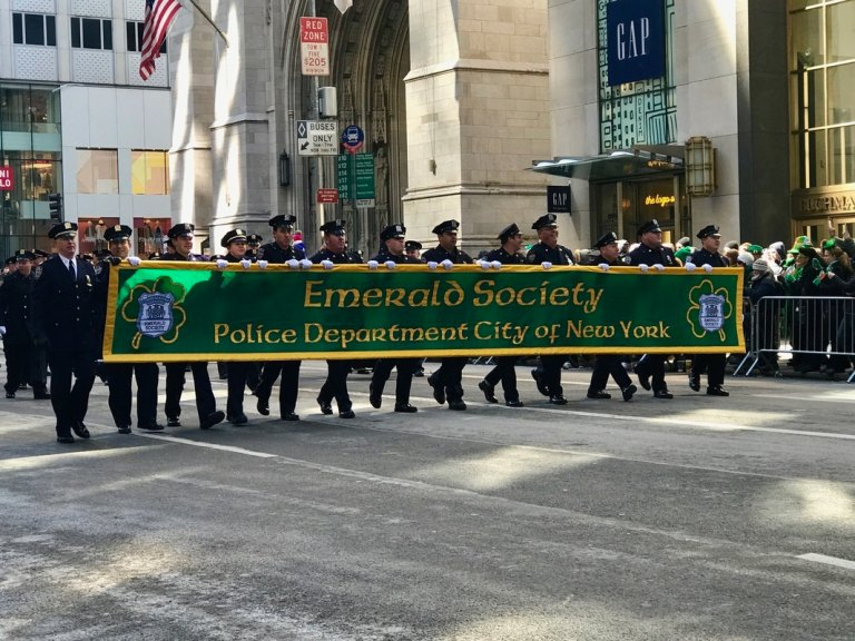 Emerald Society marching in a parade